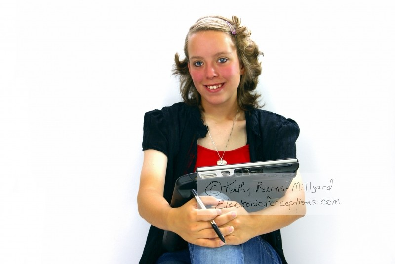 beautiful Stock Photo: Young Woman With Tablet PC