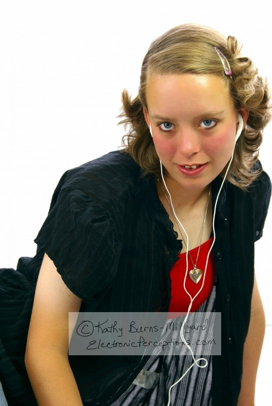 entertainment Stock Photo: Young Woman with Ear Buds