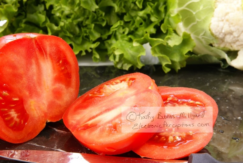 Stock Photo: Sliced Tomatoes - by Kathy Burns-Millyard