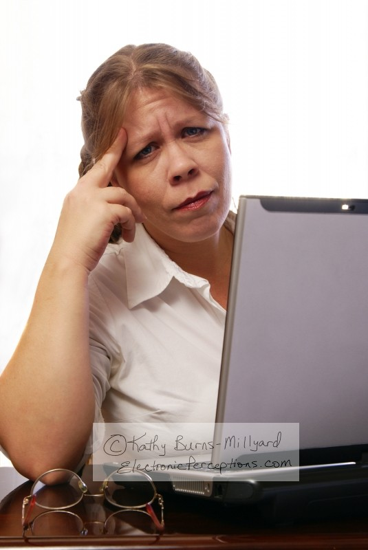 Stock Photo: Woman with Headache - by Kathy Burns-Millyard