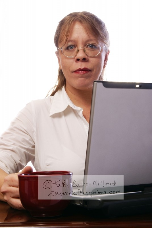Stock Photo: Woman with Convertible Notebook - by Kathy Burns-Millyard