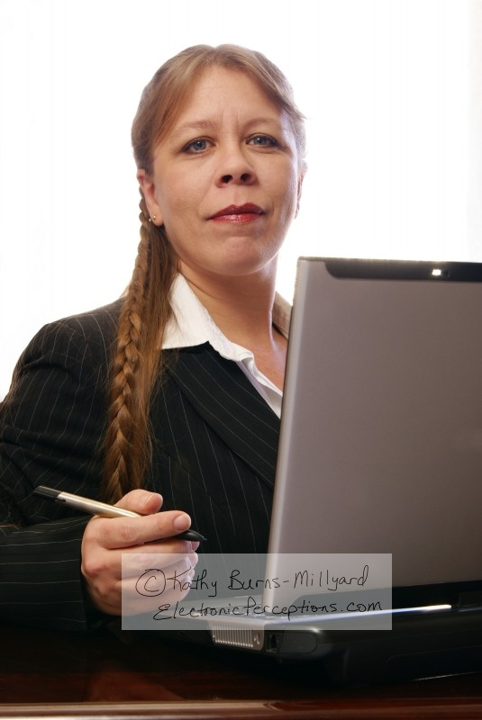 Stock Photo: Professional Woman with Convertible Notebook - by Kathy Burns-Millyard