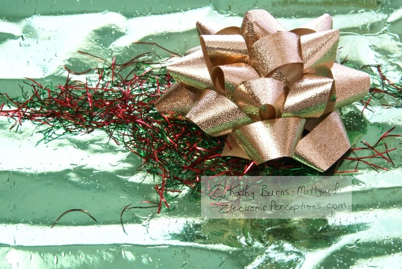 Stock Photo: Gold Bow on Green - by Kathy Burns-Millyard