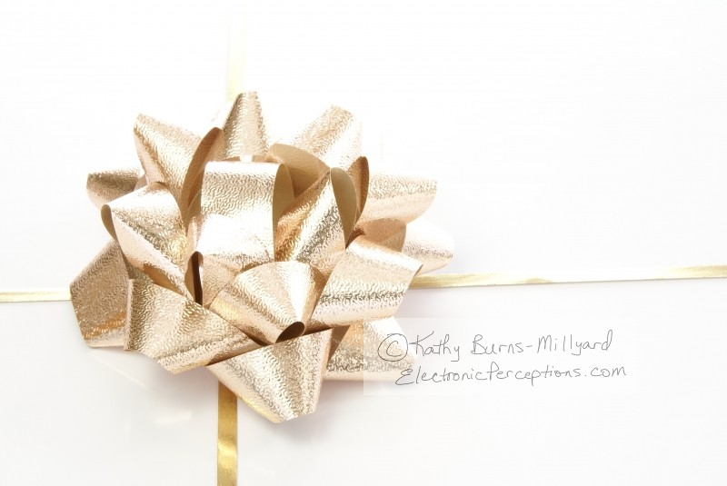 Stock Photo: Gold Foil Bow - by Kathy Burns-Millyard