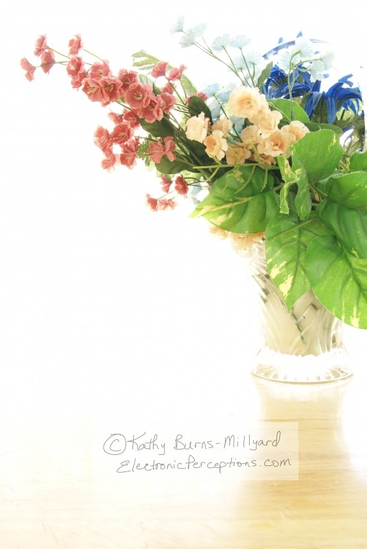 flower Stock Photo: Silk Flowers in Glass Vase