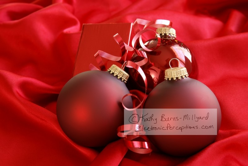 Stock Photo: Red Christmas Decorations - by Kathy Burns-Millyard