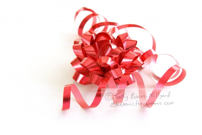 Stock Photo: Red Bow and Ribbon - by Kathy Burns-Millyard