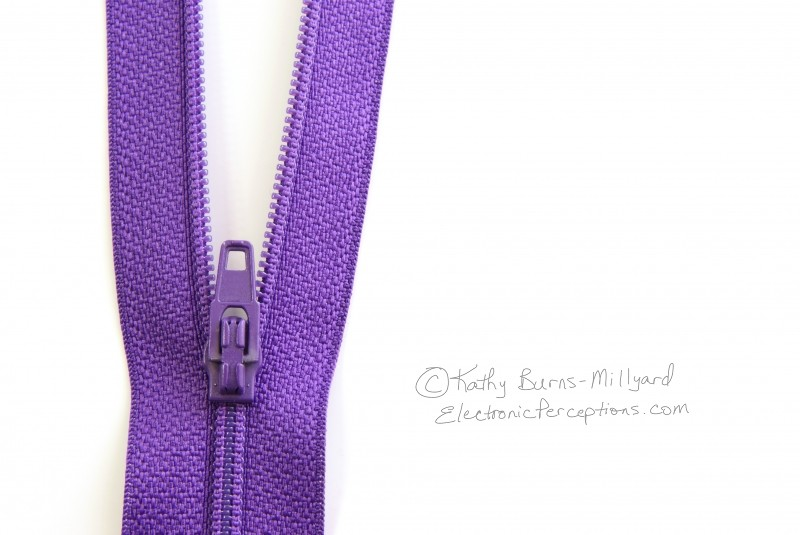 fabric Stock Photo: Purple Zipper