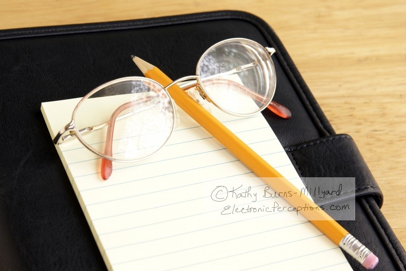 Still Life Stock Photo: Eyeglasses and Notepad