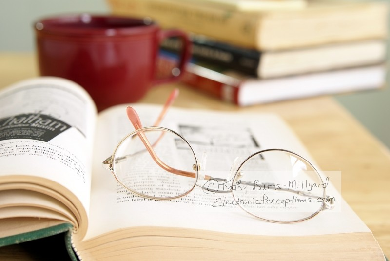 Still Life Stock Photo: Eyeglasses On Open Book