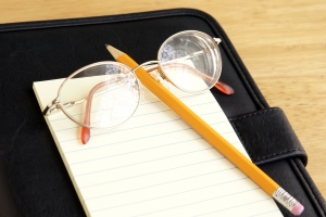 Stock Photo Thumbnail: Eyeglasses and Notepad